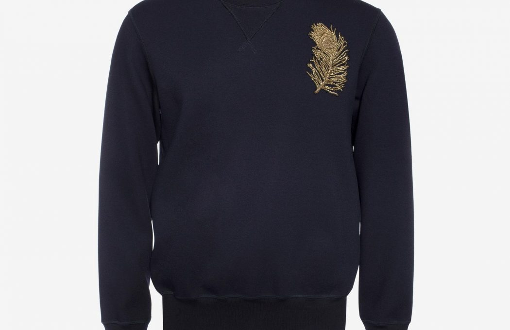 Navy crepe jersey sweatshirt with gold bullion peacock feather embroidery on chest. Ribbed crew neck, cuffs and hem.
