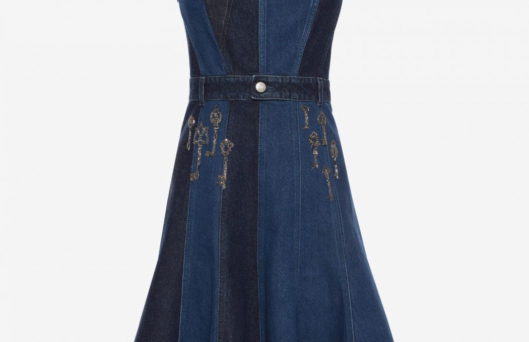 Paneled sleeveless mini dress with hand-appliquéd Magical Map embroidery motifs. Featuring raw frayed edges and a decorative waist belt with a single button on center front. Invisible zipper fastening on center back.